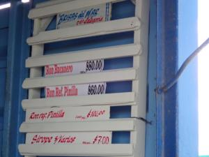 drankhandel Manzanillo. 2 liter lekkere rum $100 is €4.-!